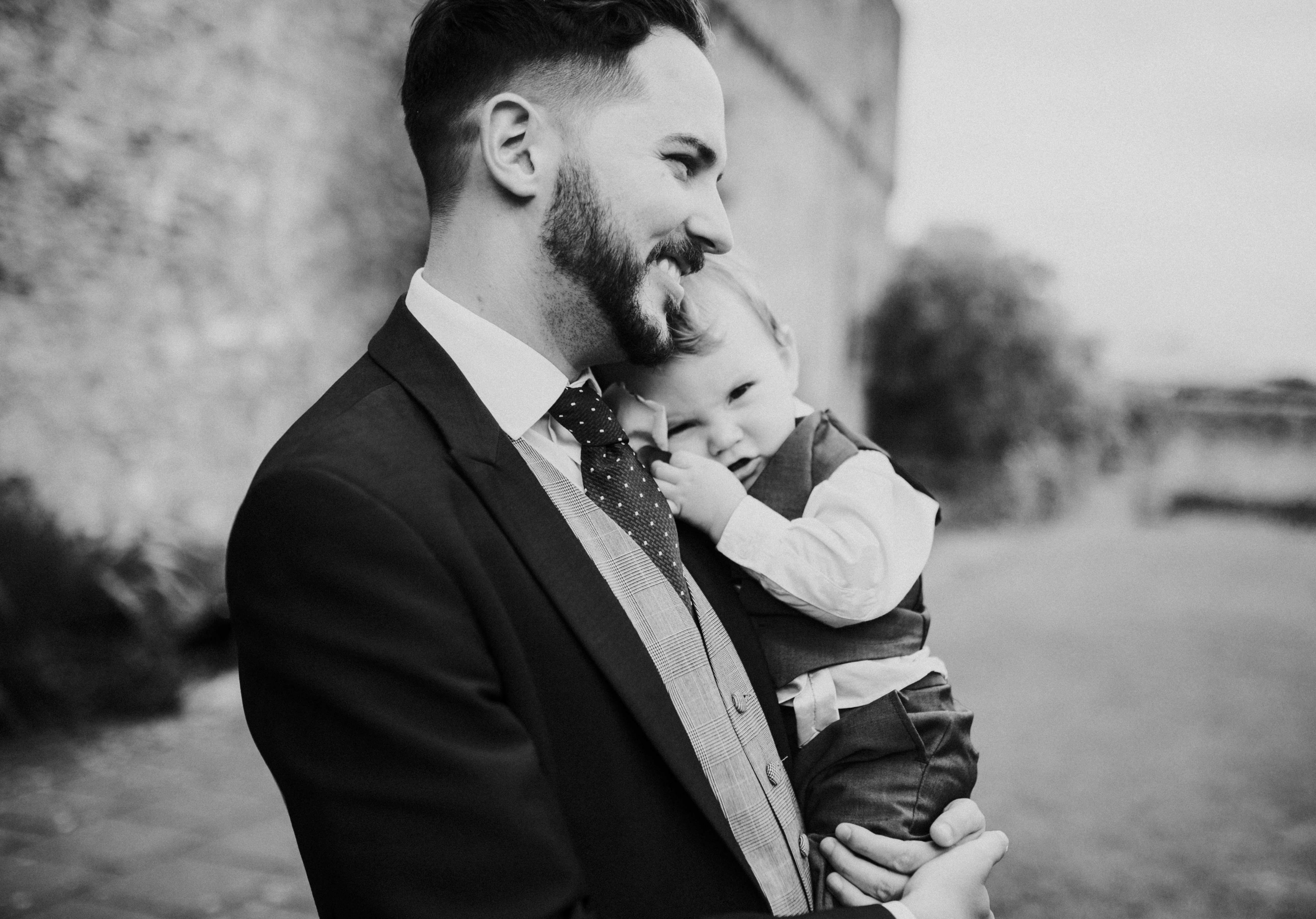 groom and baby