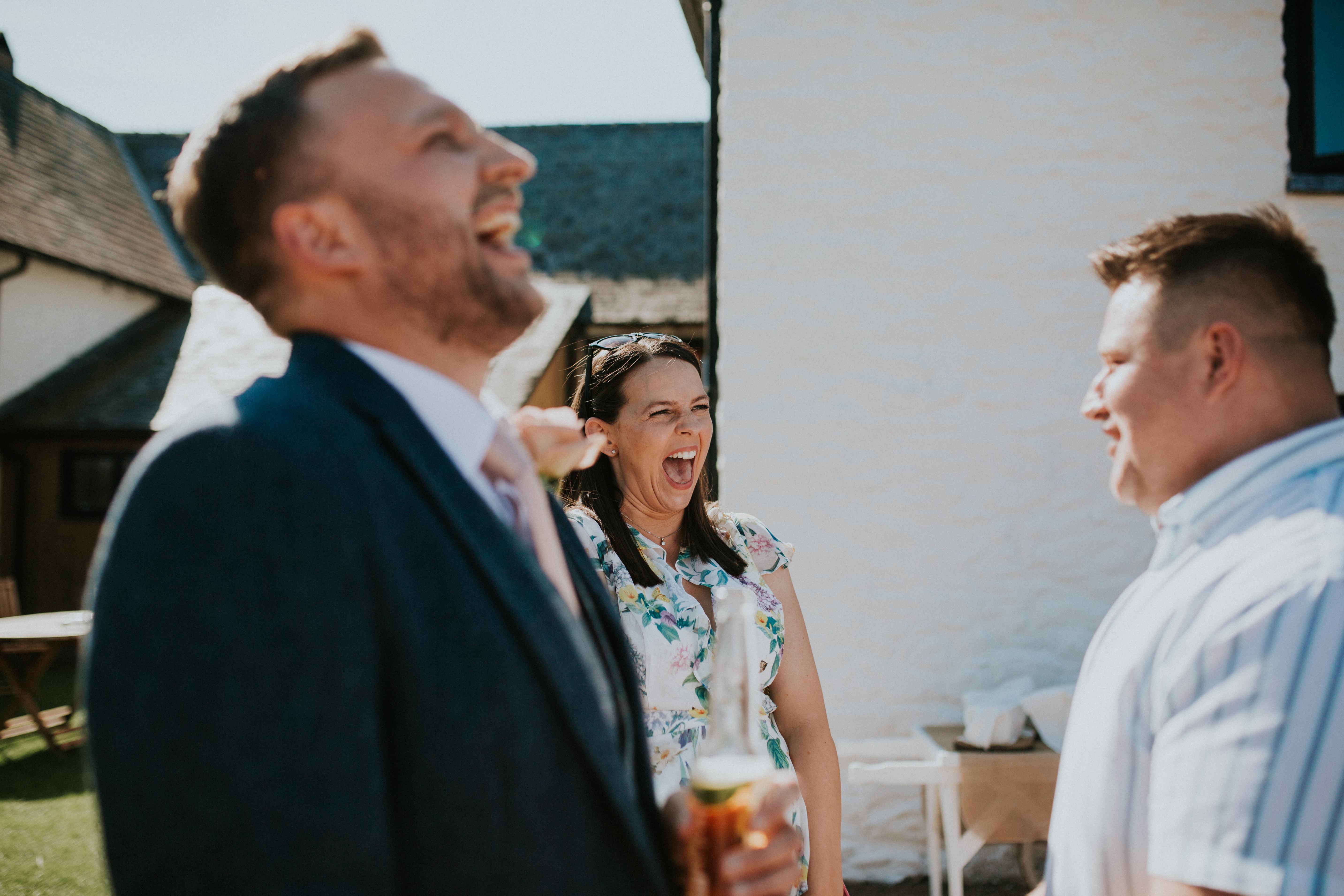 guests laughing at magician