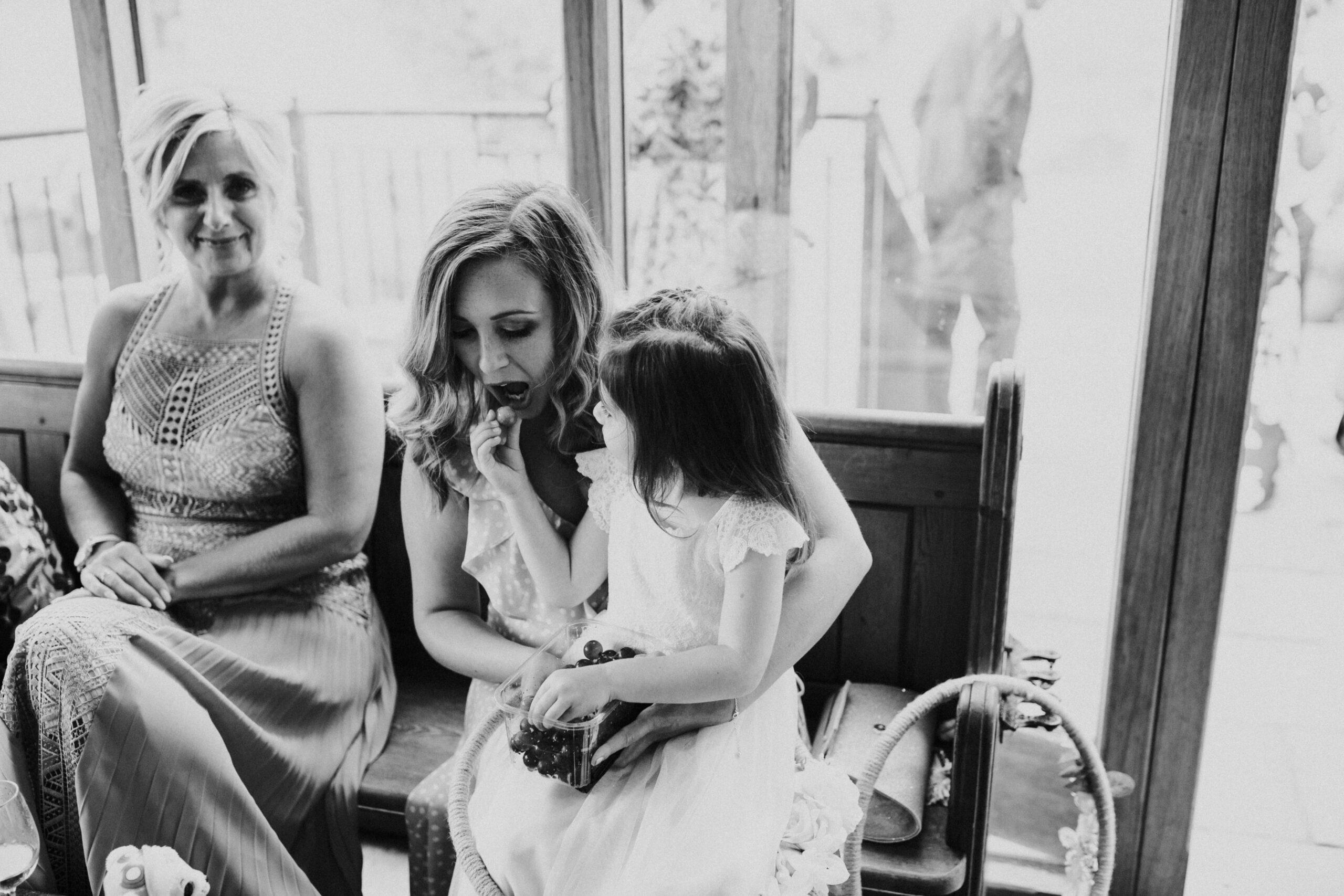 little girl feeding guest sweets