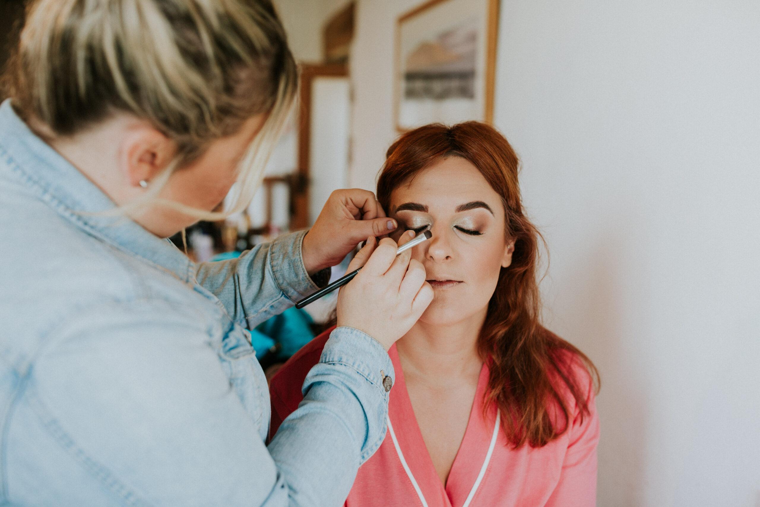 bridesmaid having her make-up done