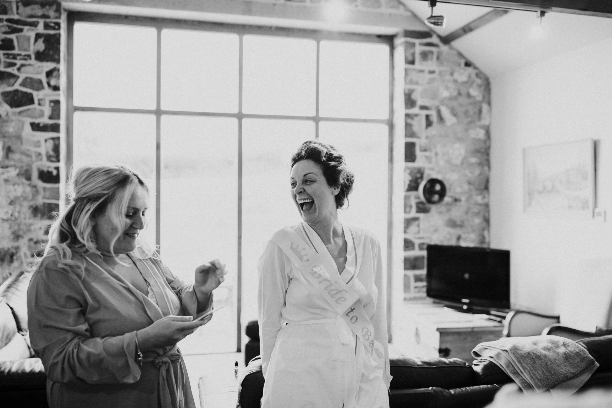 bride laughing with the bridesmaid