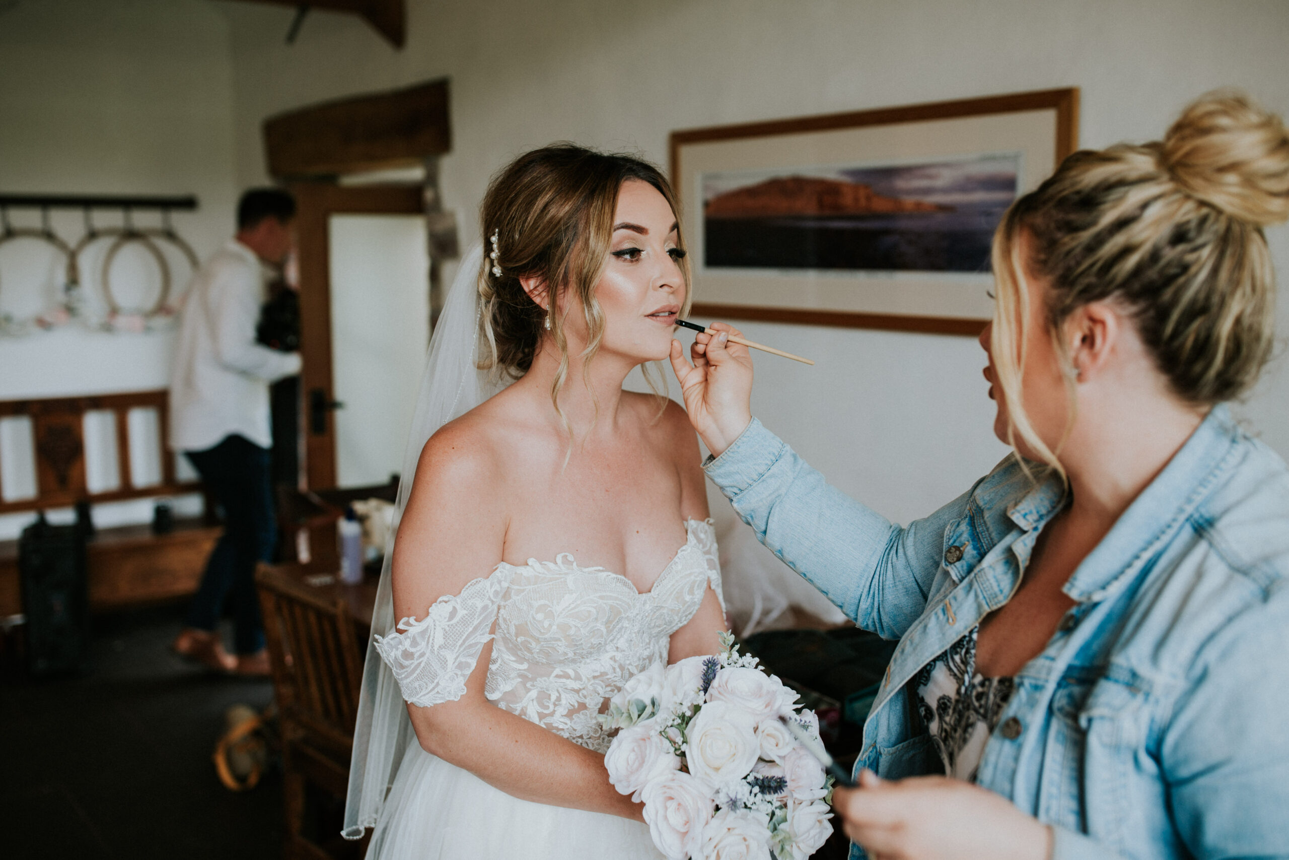 bride topping up her lipstick