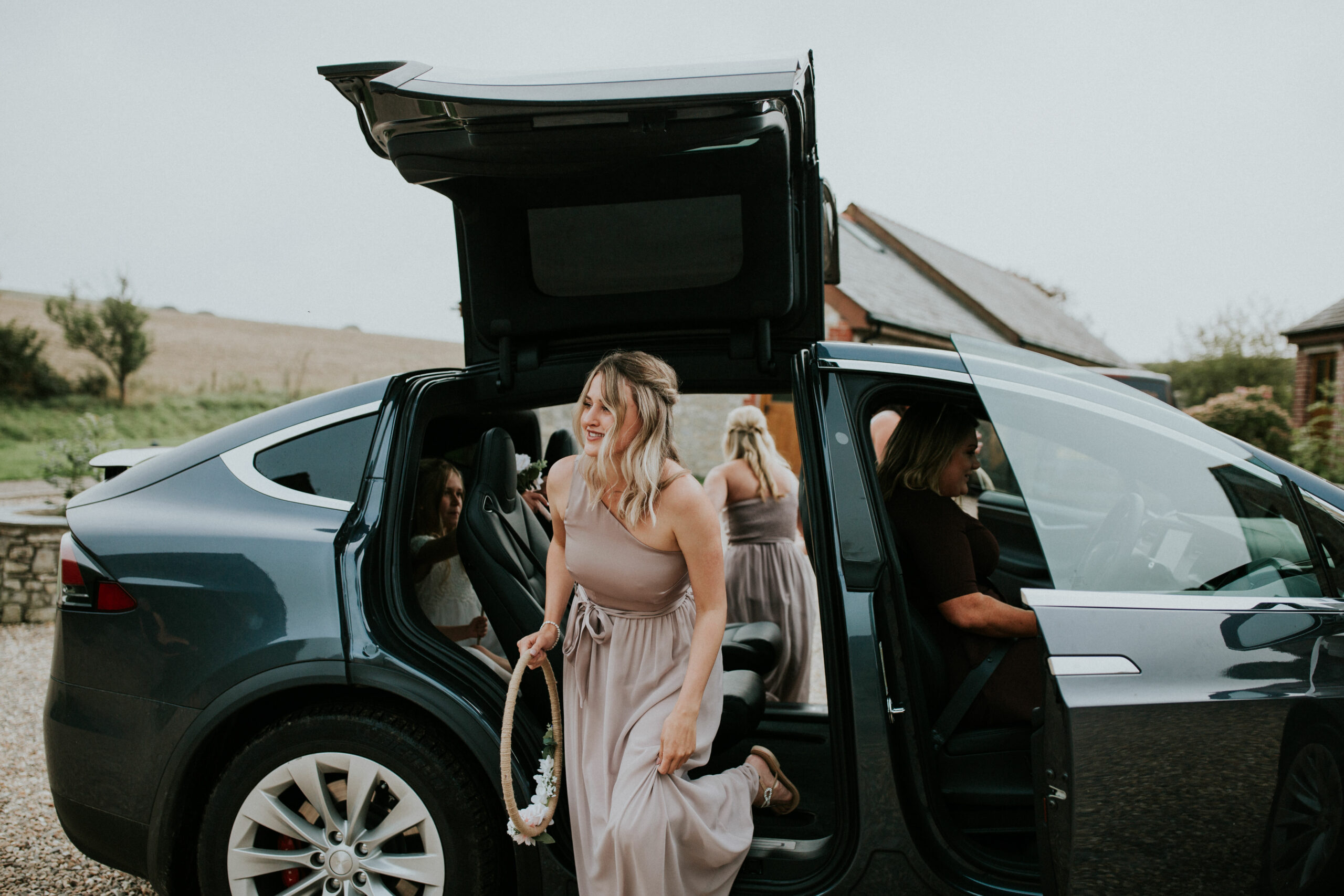bridesmaids get out of the car