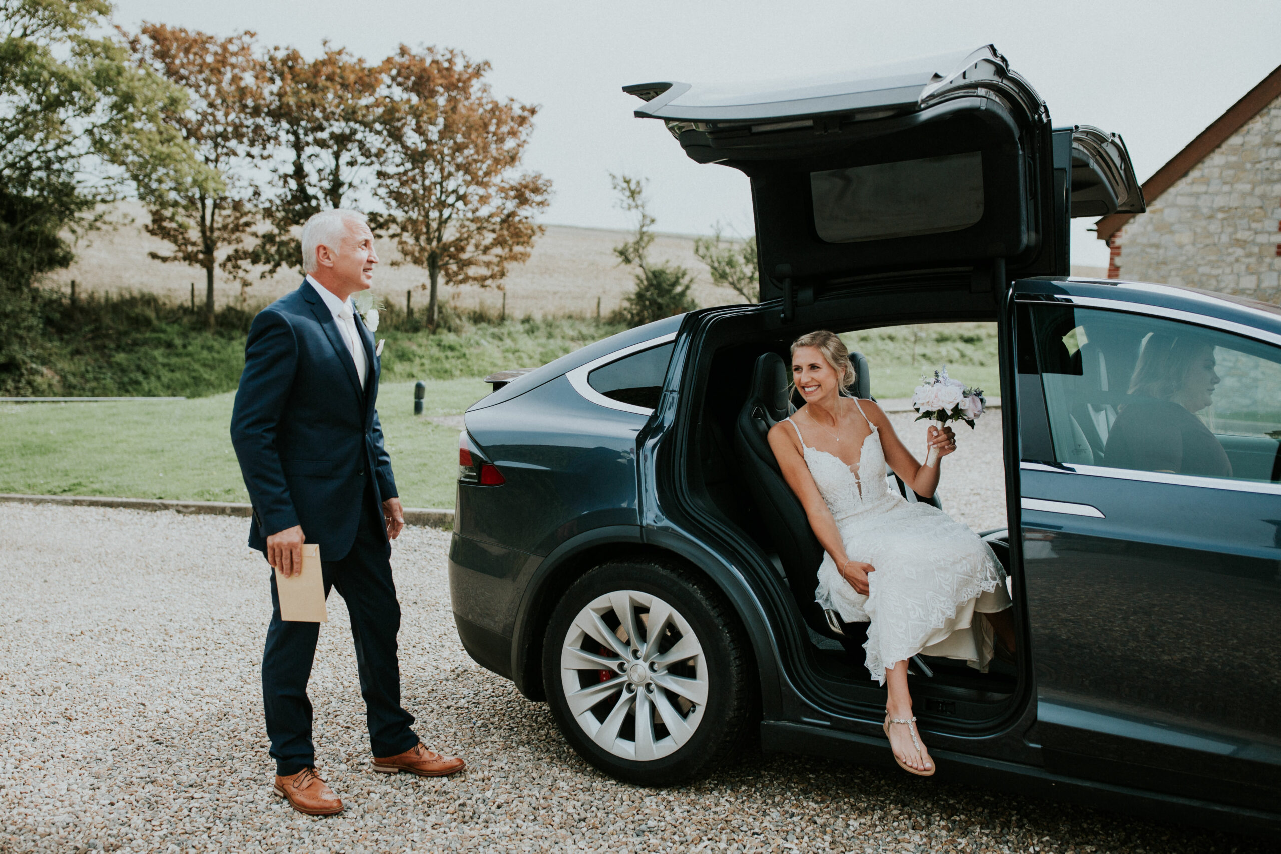 bride gets out of her car