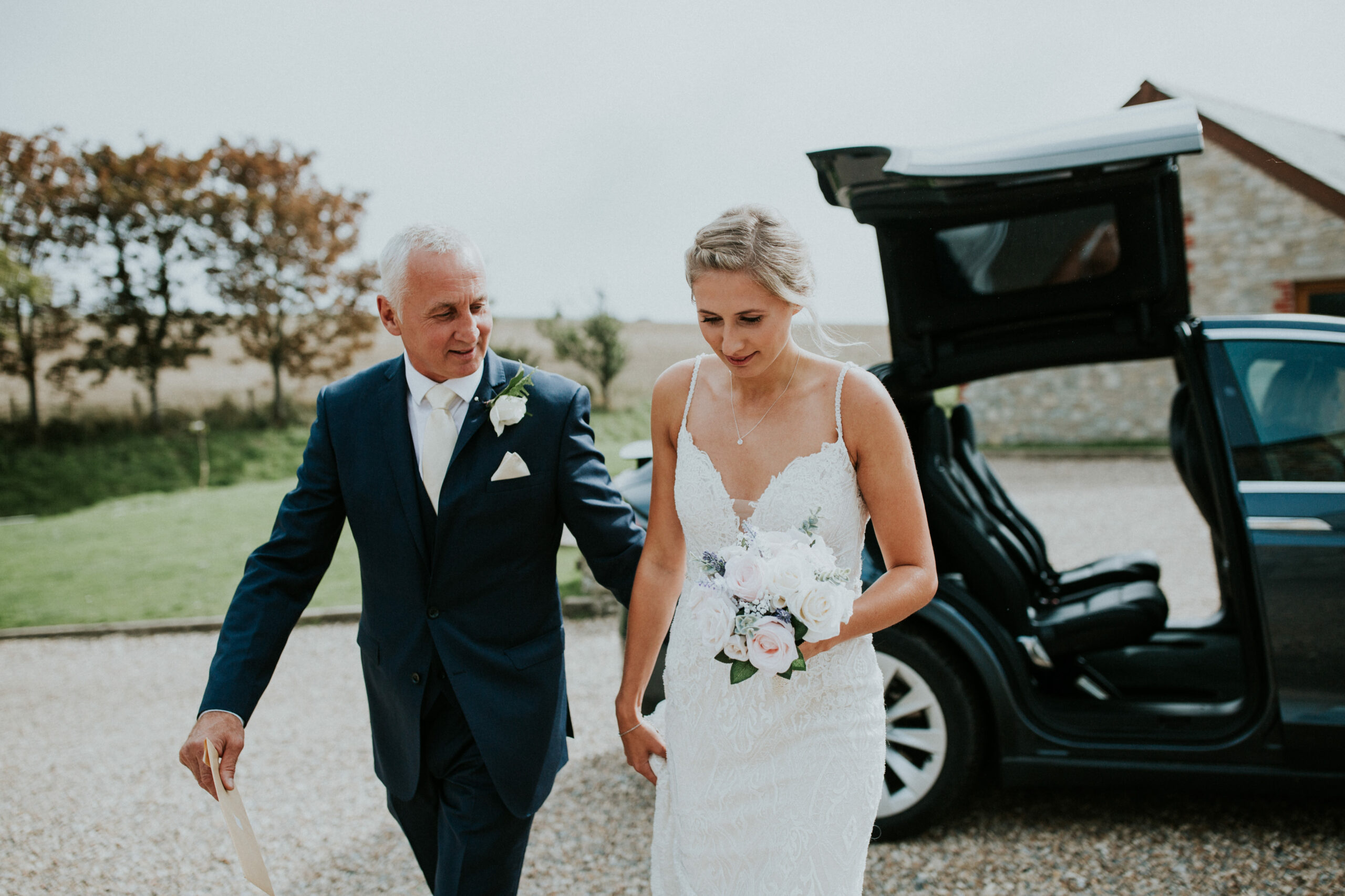 bride and her father walk into the ceremony