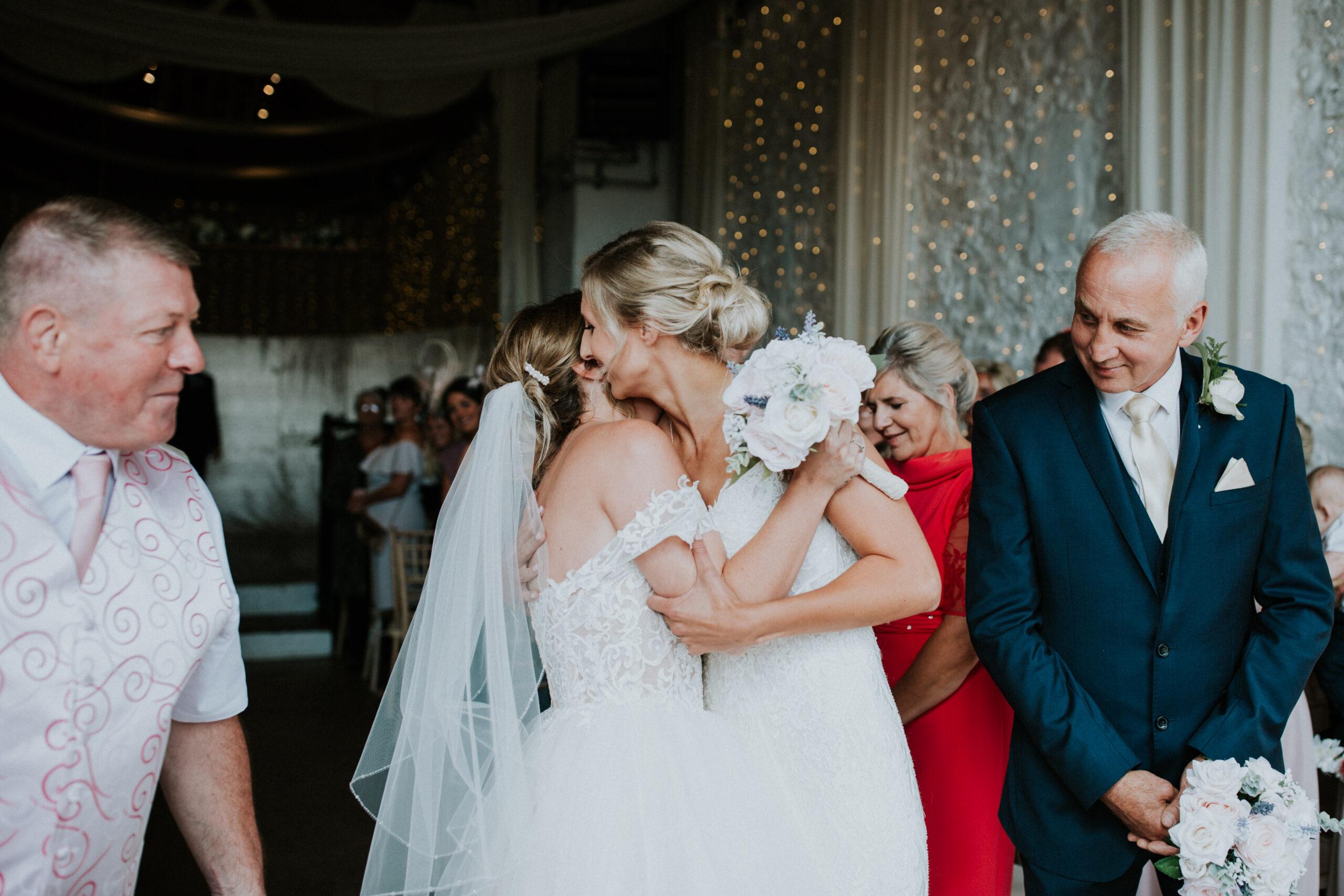 brides hugging