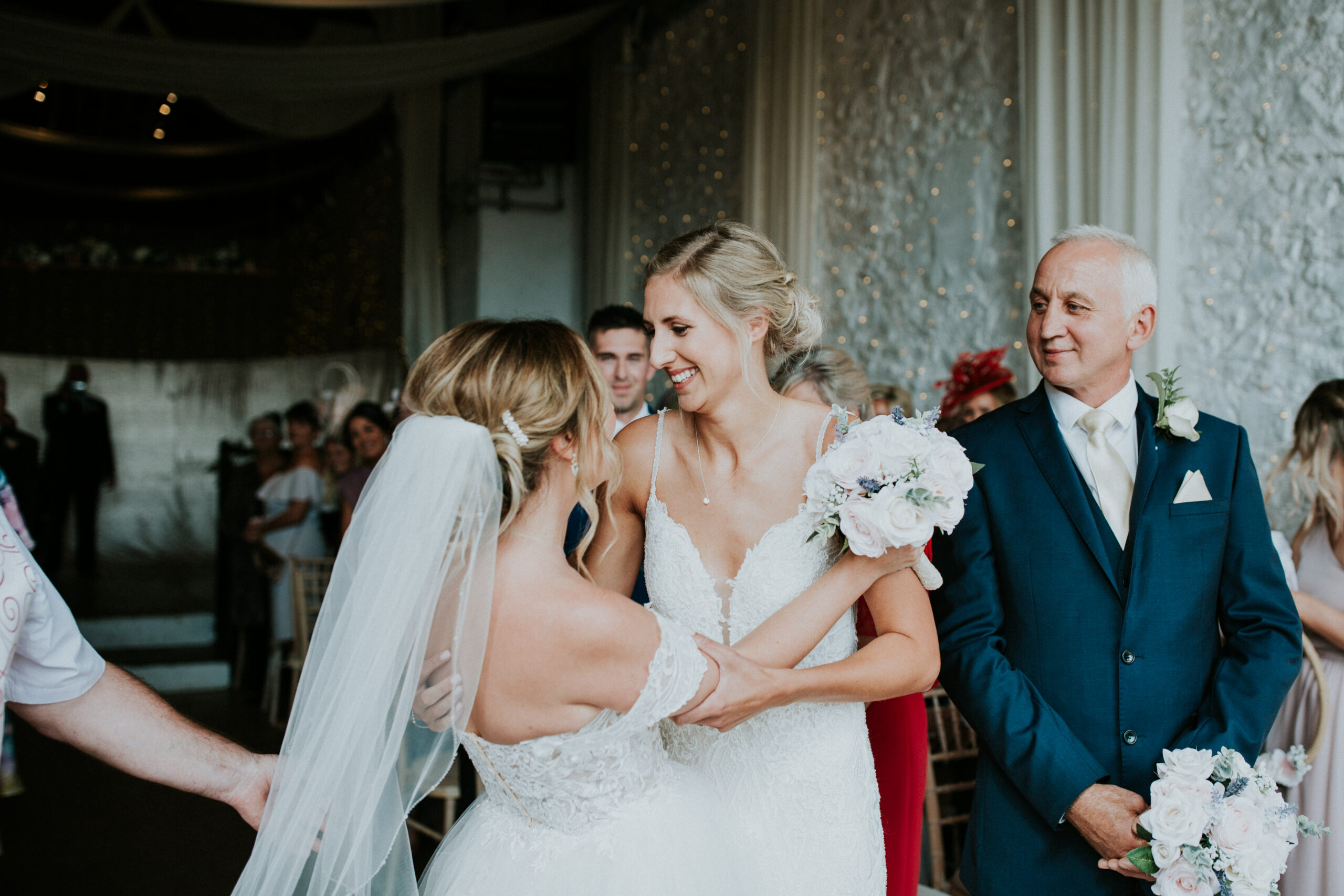 brides smiling at each other
