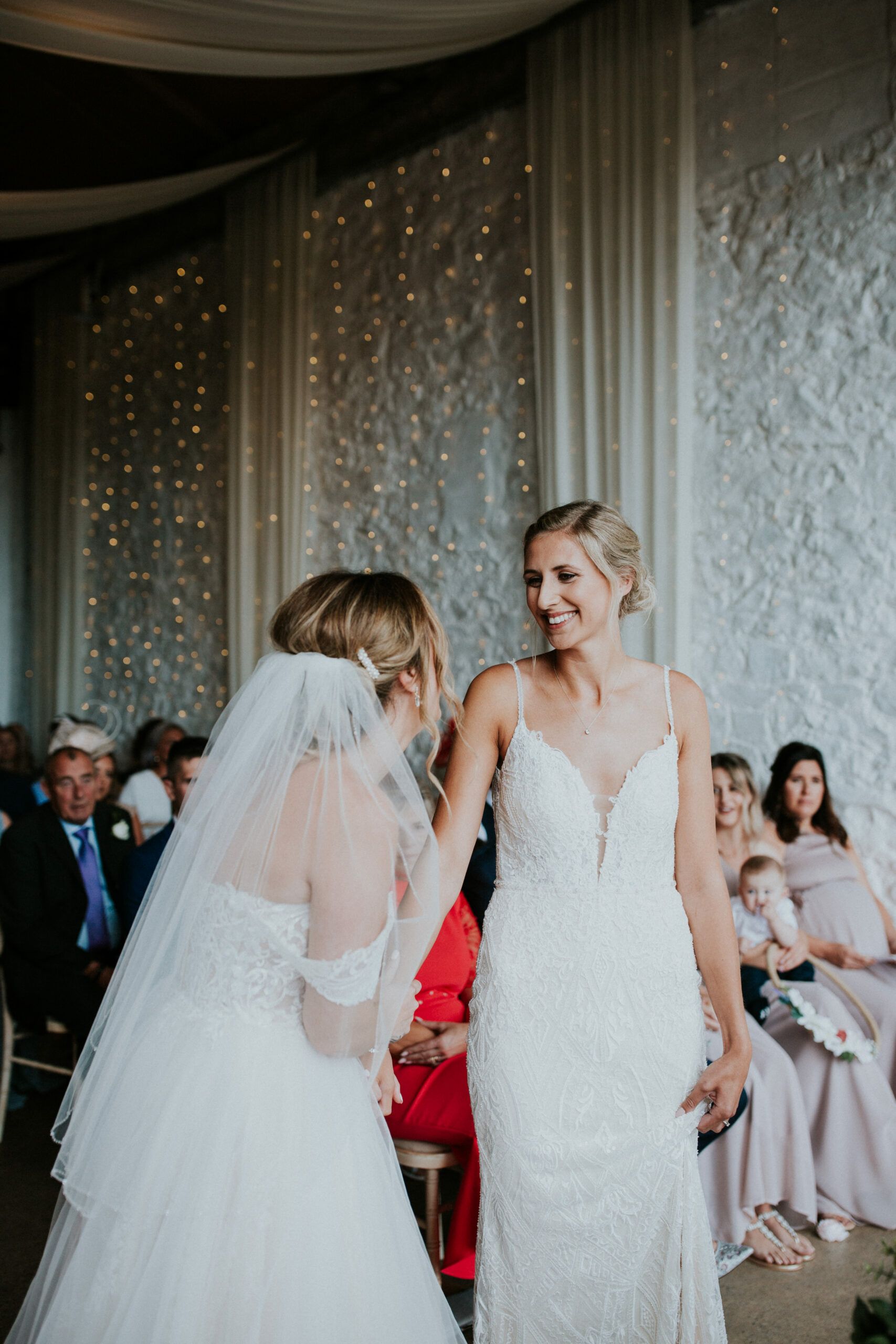 brides smiling in the ceremony