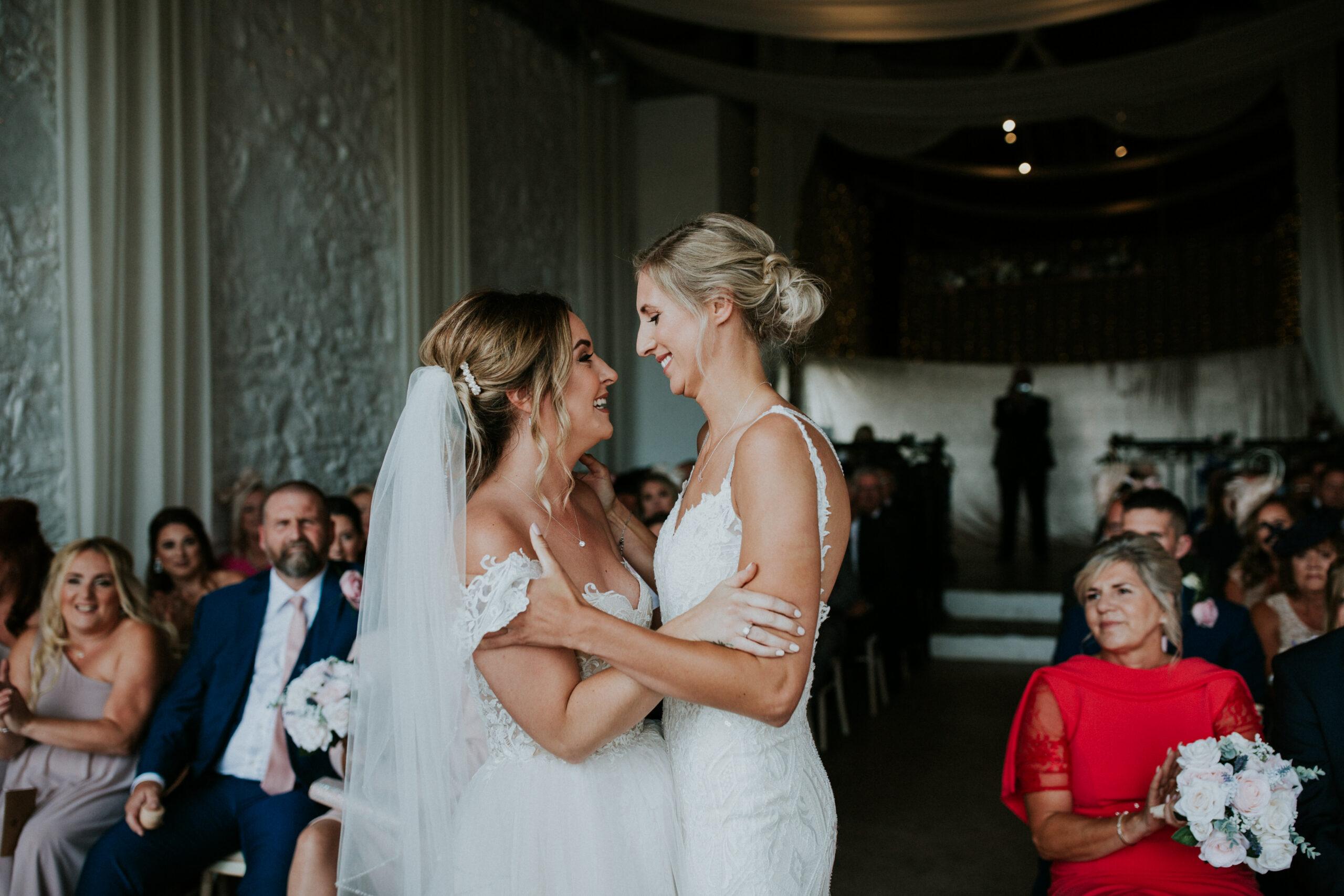 brides exchanging their vows