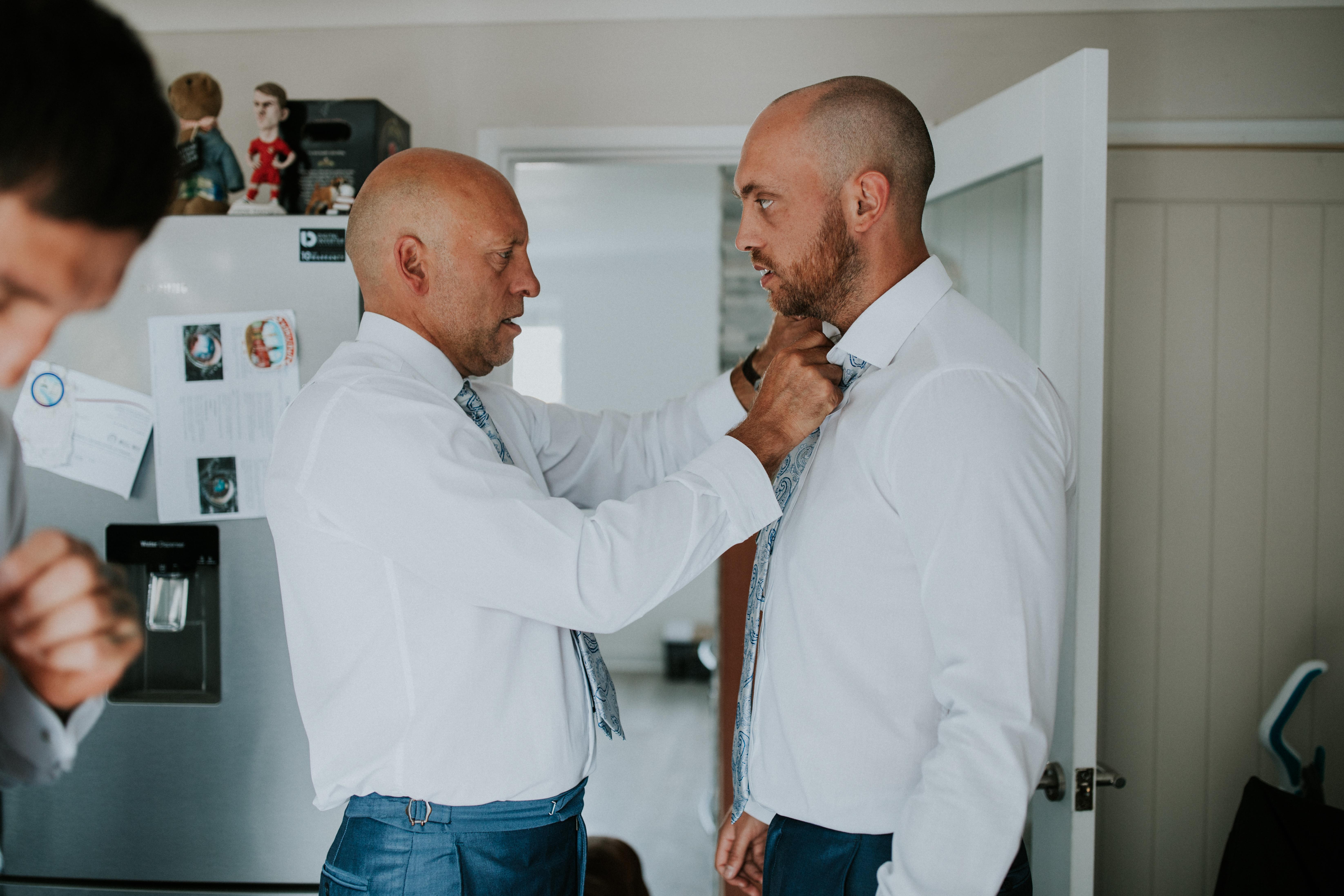 dad doing sons tie