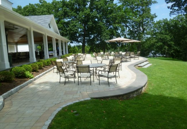 A dining terrace provides seating overlooking the 9th green.