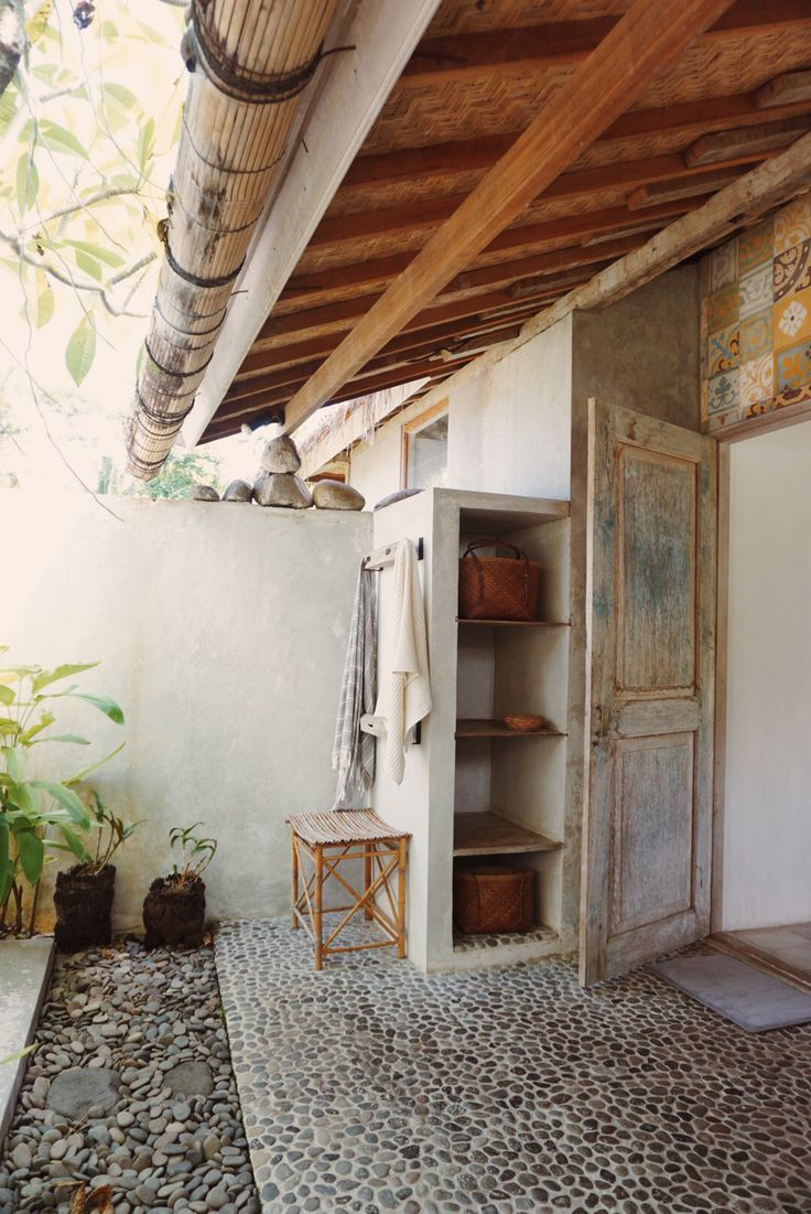pebbles and tiles in this magical outdoor bathroom