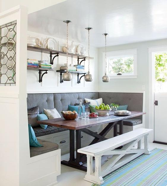 Breakfast nook design with built-in furniture and open wall shelves