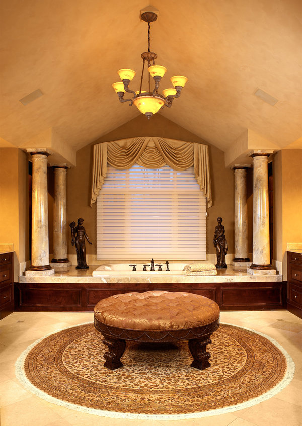 In this gorgeous Master Bath a paint treatment was used on the columns to make them look like marble