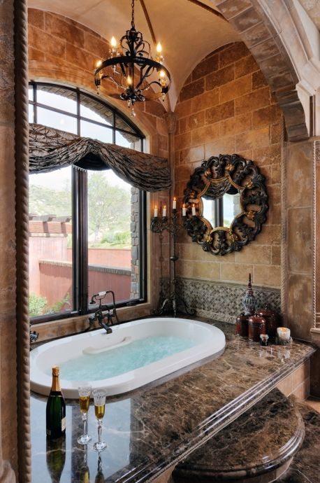 Luxurious Traditional Master bathroom design featuring marble finished