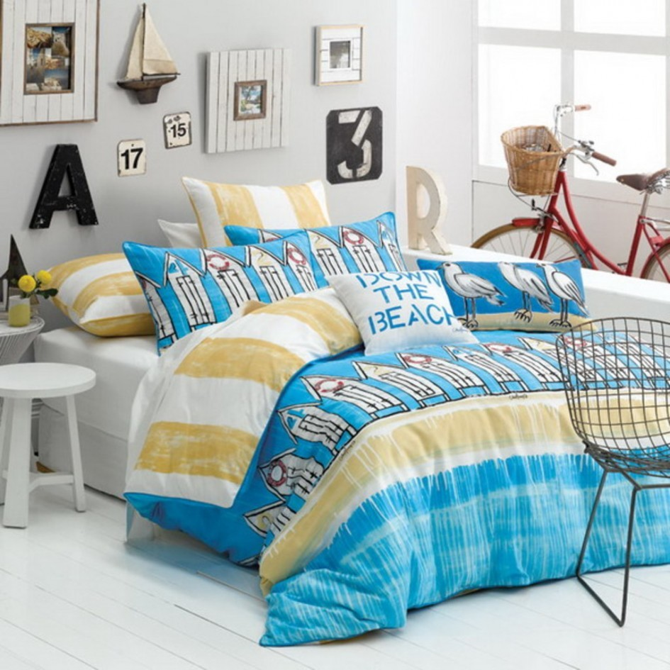 Beach style bedroom with white Beadboard Floor White Stool Blue Pattern Quilt Down