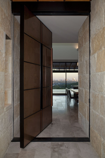 Custom contemporary designed door coverd with stones