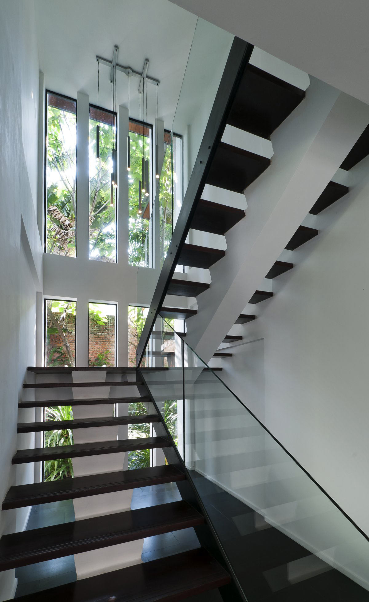 Dark Wood & Glass Stairways