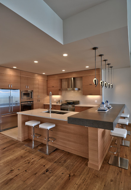 contemporary kitchen with wood flooring and shelf along with pendant lights