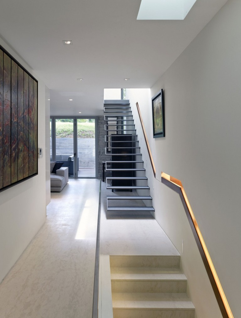 metal-staircase-beige-granite-floor