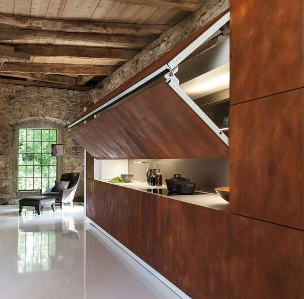 Contemporary kitchen design with folding front panels in rich brown color