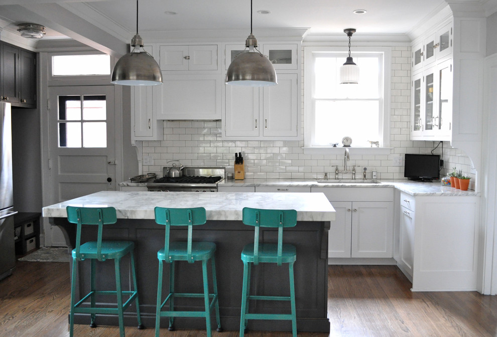 Eclectic Kitchen Design with island and turquoise color chairs