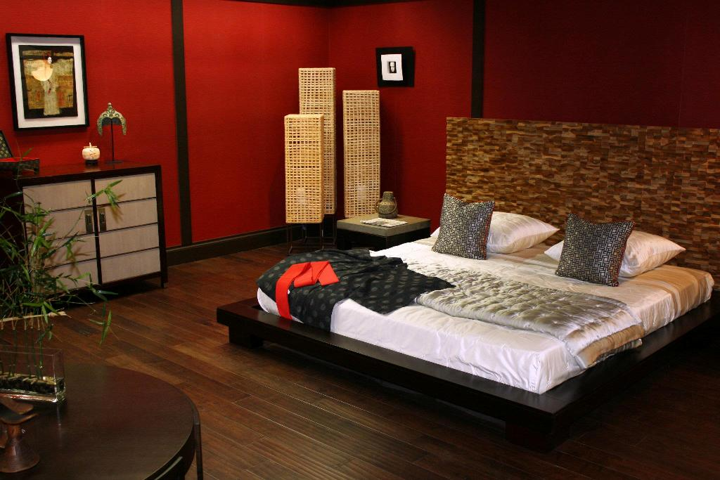 master-bedroom-design-with-beautiful-wood-laminating-floor-and-red-wall