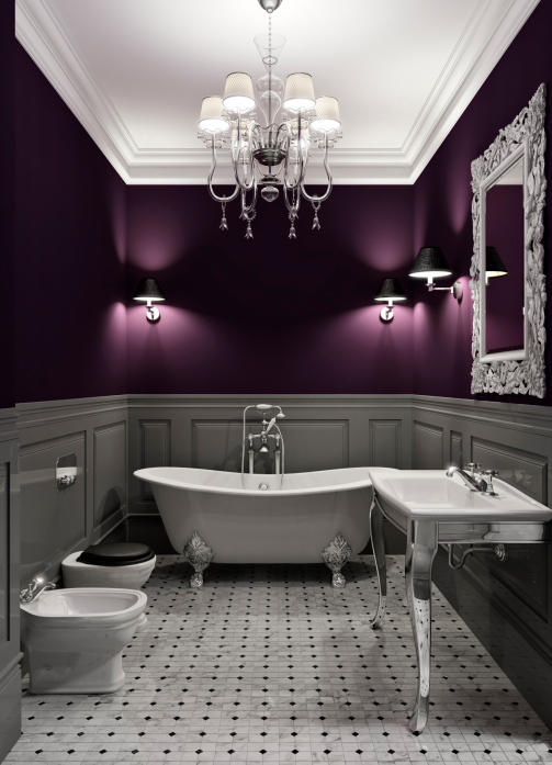 Elegant white and purple bathroom with claw tub and chandelier