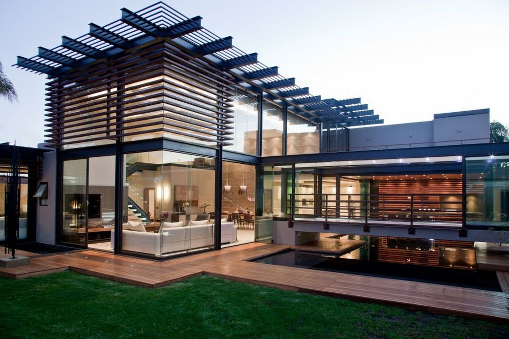 Home-Exterior-Design-Idea-with-Glass-Wall-and-Green-Grass
