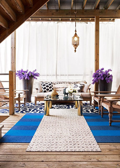 outdoor space layered rugs