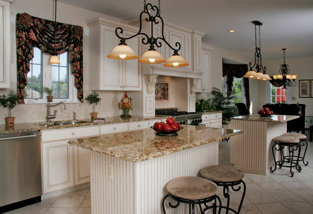 traditional-white-kitchen-featuring-floor-to-ceiling-cabinets-an