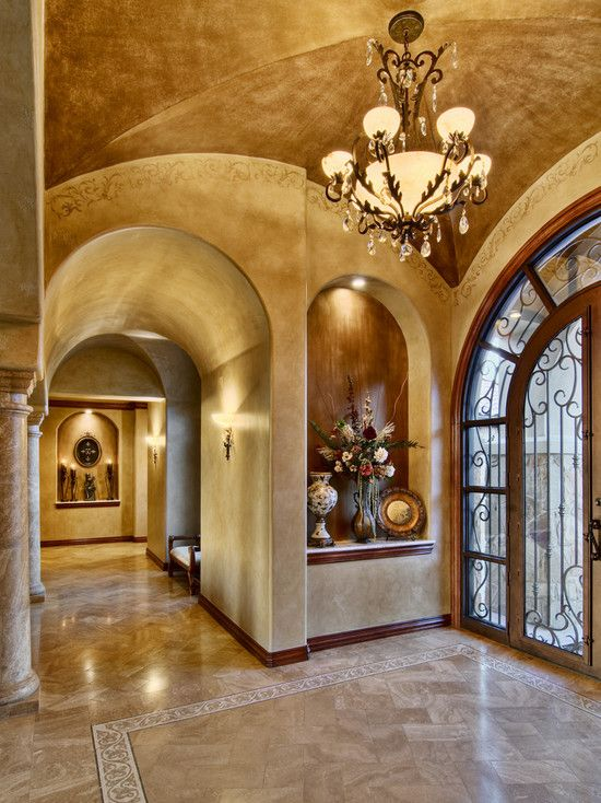 Beautiful tuscan entry way with huge art niche gorgeous lighting