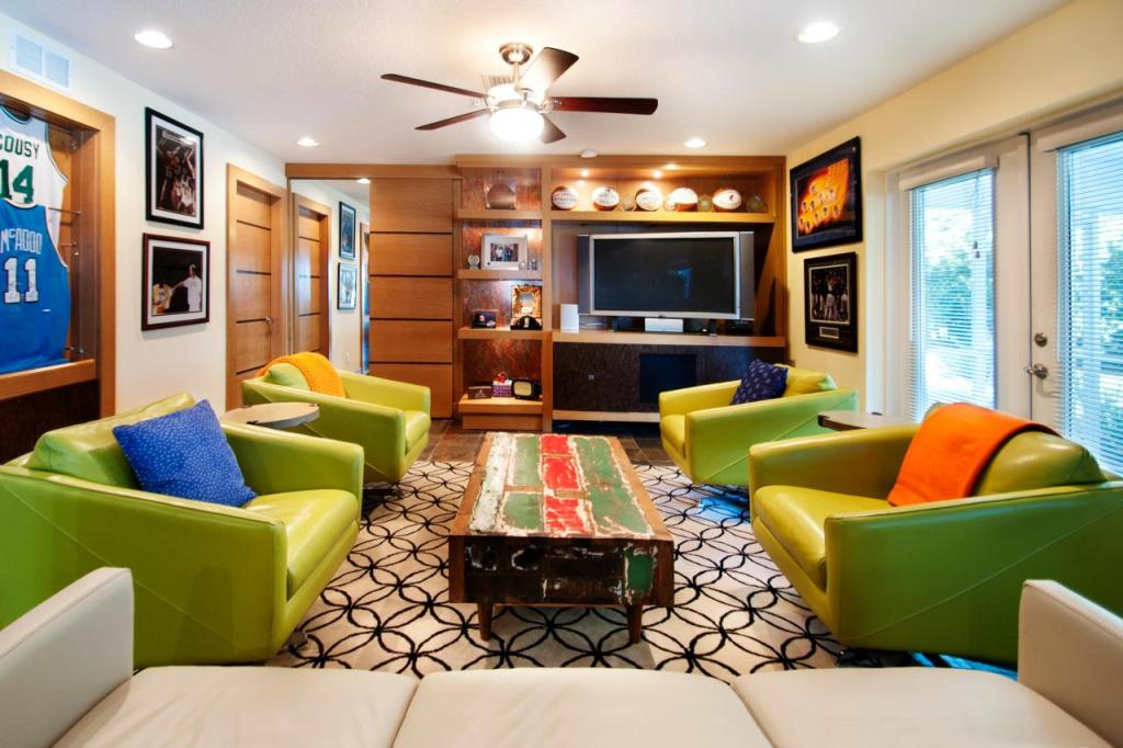 Sports Themed Basement With Comfy Seating Area