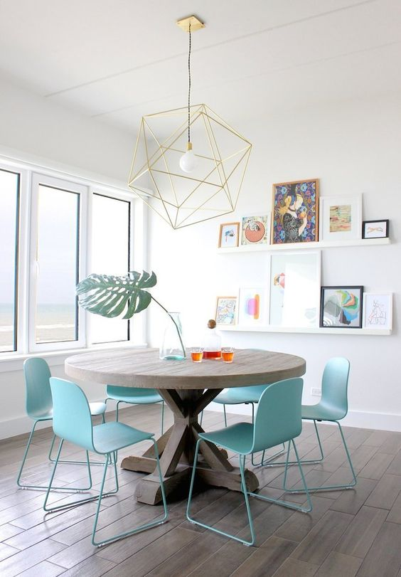 Turquoise Eclectic dining room featuring a lovely gallery wall