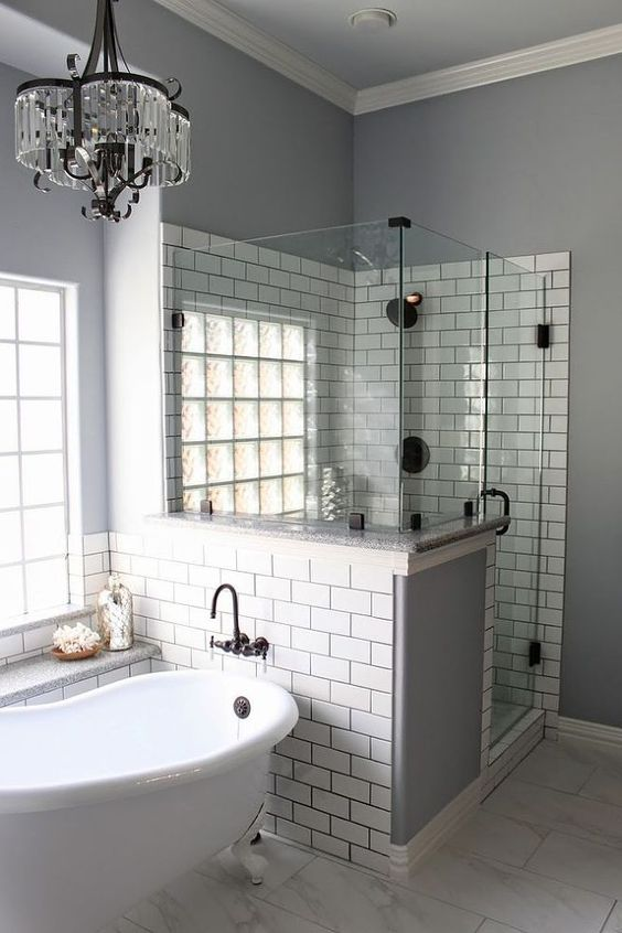 Modern Bathroom With Subway Tiles & Glass Door