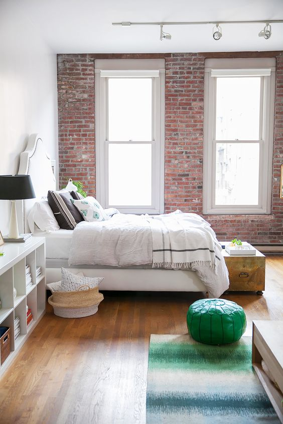 bright-bedroom-with-exposed-brick-walls
