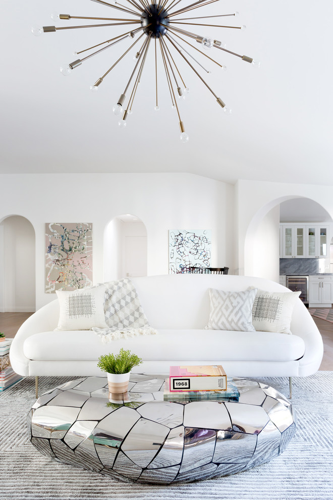 Large Midcentury Living Room With White Wall