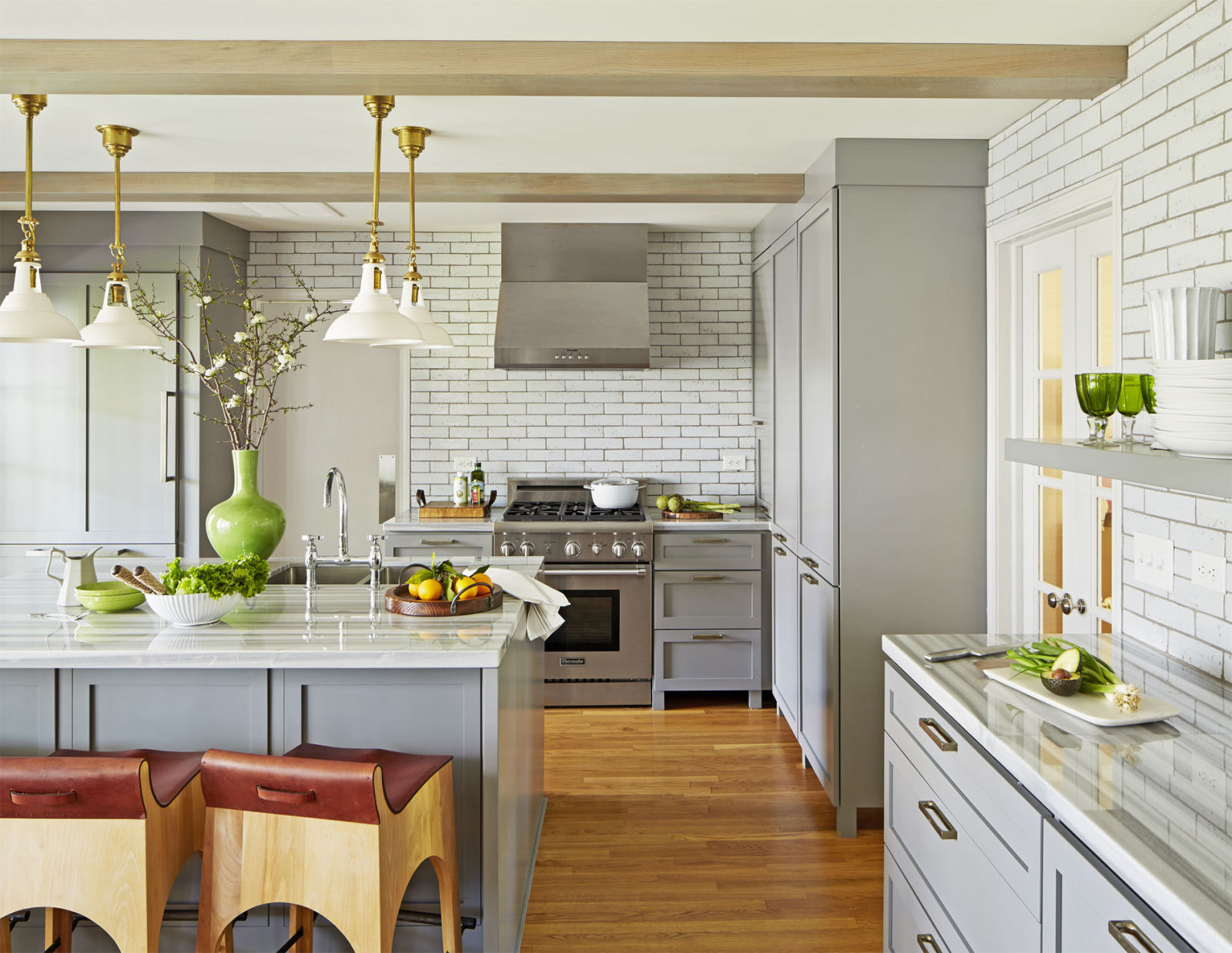 Kitchen With Beige Hardwood Flooring & White Wall