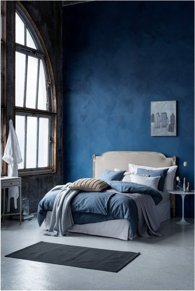 Loft Style Bedroom With Petroleum Blue Color Wall