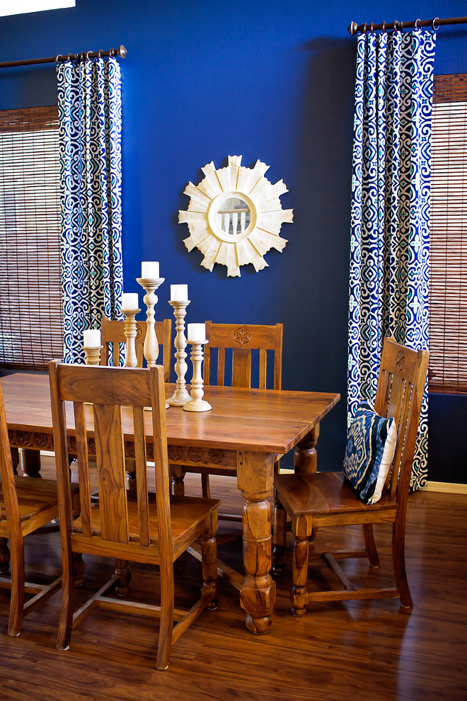 Mediterranean Dining Room With Blue Curtains