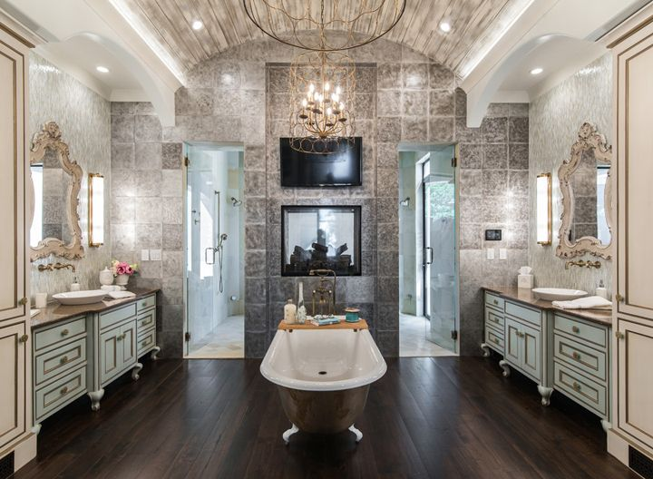 luxurious master bathroom with clawfoot tub and fireplace