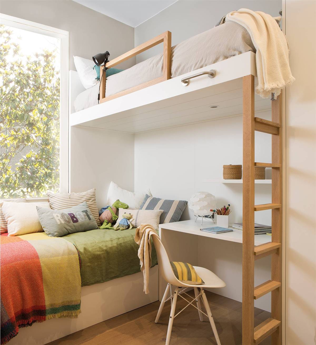 A MINI ROOM WITH TWO BEDS AND A STUDY AREA