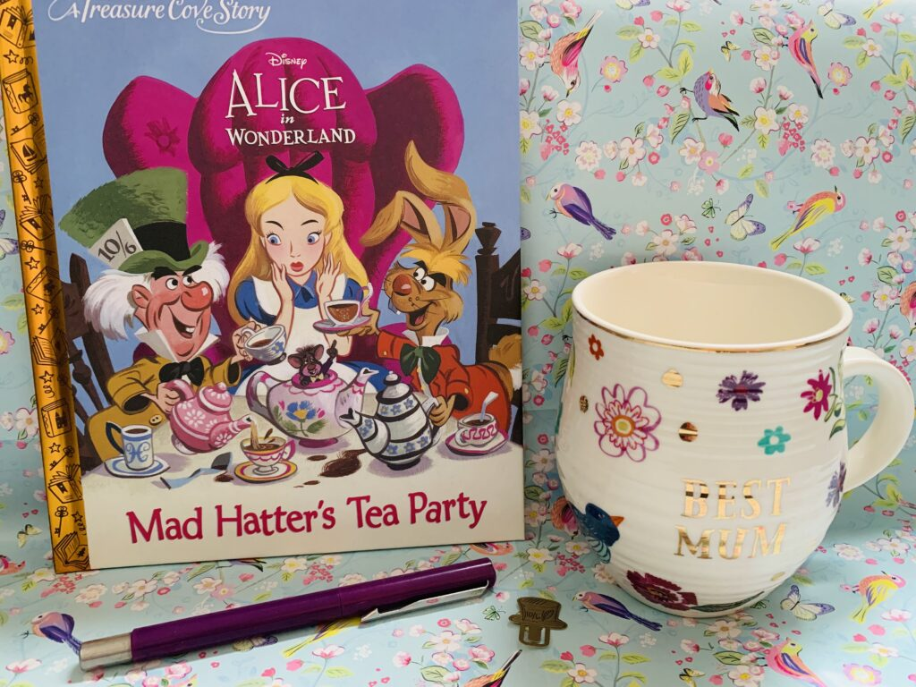 Picture of Alice in WOnderland book with Best Mum mug and background display