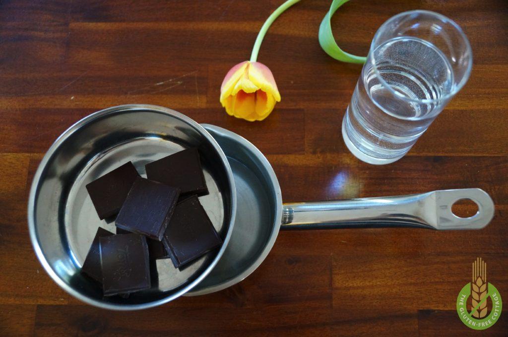 Let the chocolate melt in a warm water bath (gluten-free chocolate-walnut muffins).