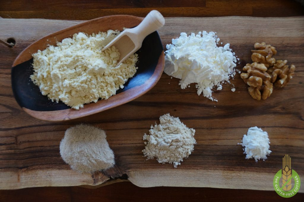 Whisk millet flour, corn starch, finely chopped walnuts, psyllium husk powder, locust bean gum powder and baking powder (from left to right) in another medium-sized bowl (gluten-free chocolate-walnut muffins).