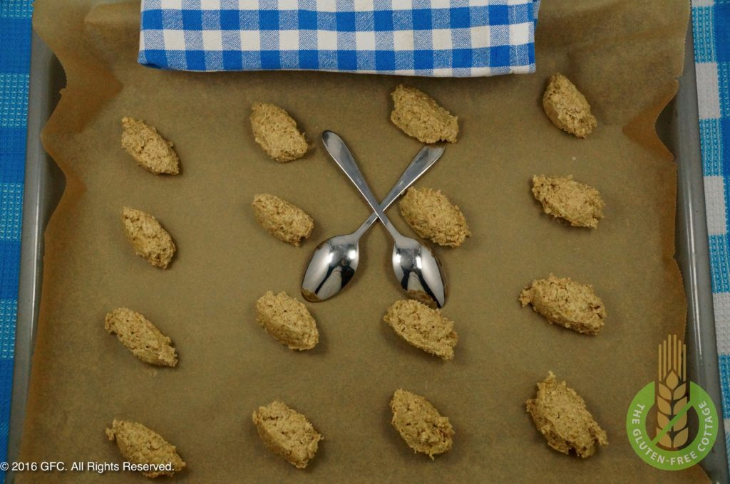 Use two teaspoons to make small dough dumplings and set on parchment paper (gluten-free oatmeal cookies).