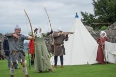 Lady Helen loosens an arrow