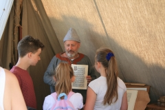 The scribe shows examples of his work