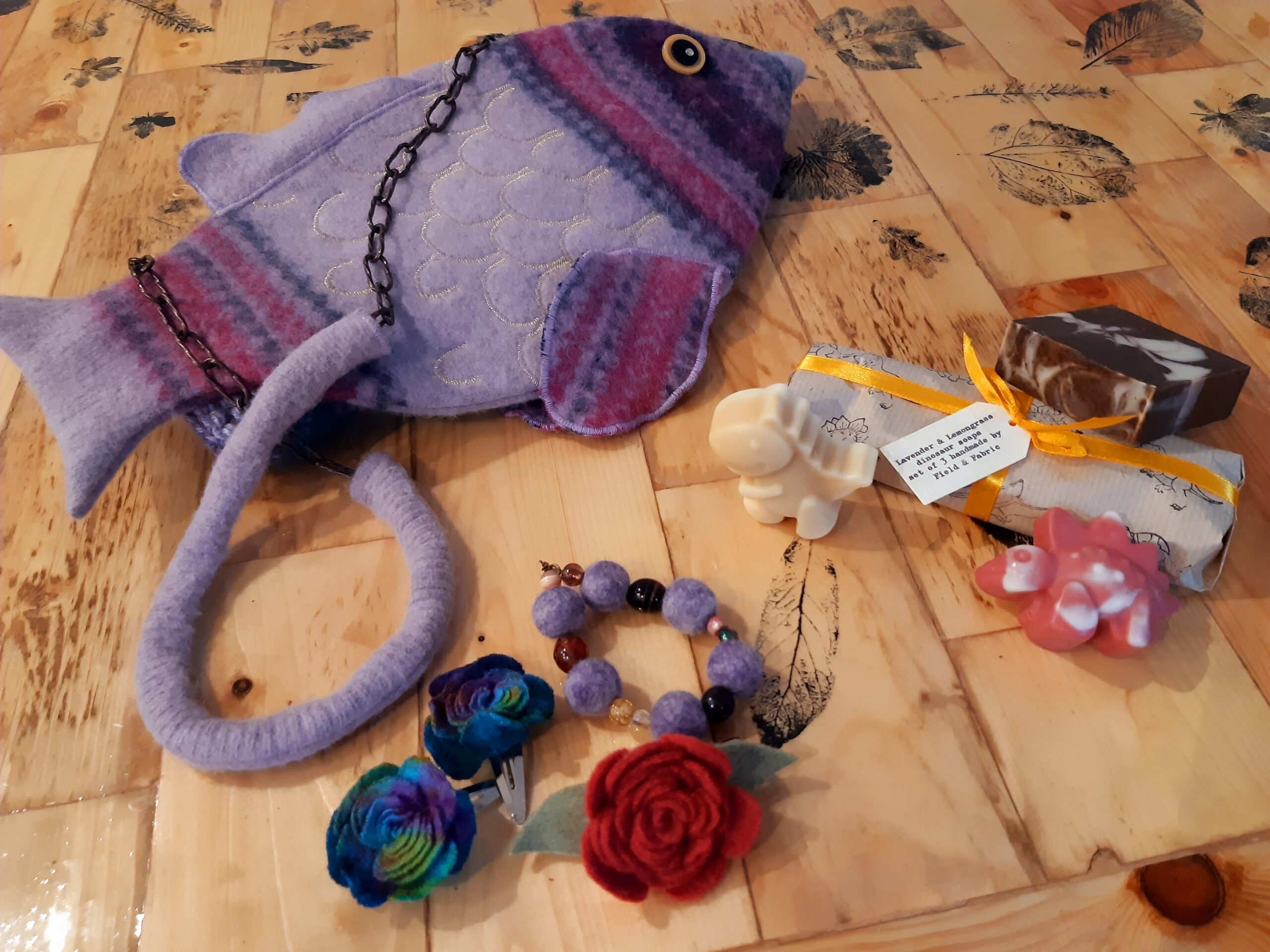 Fish-shaped bag, handmade soaps, and hair accessories from Field and Fabric