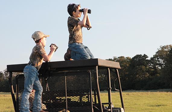 Kids using binoculars